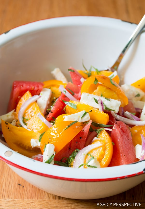 Fresh and Easy Watermelon Feta Salad with Golden Tomatoes and Tarragon on ASpicyPerspective.com #salad #chopsalad