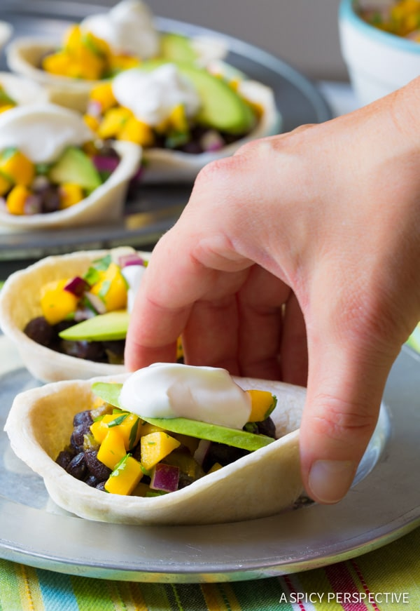 The Best Ever Mini Black Bean Tacos with Mango Pico de Gallo on ASpicyPerspective.com #mexican #vegetarian