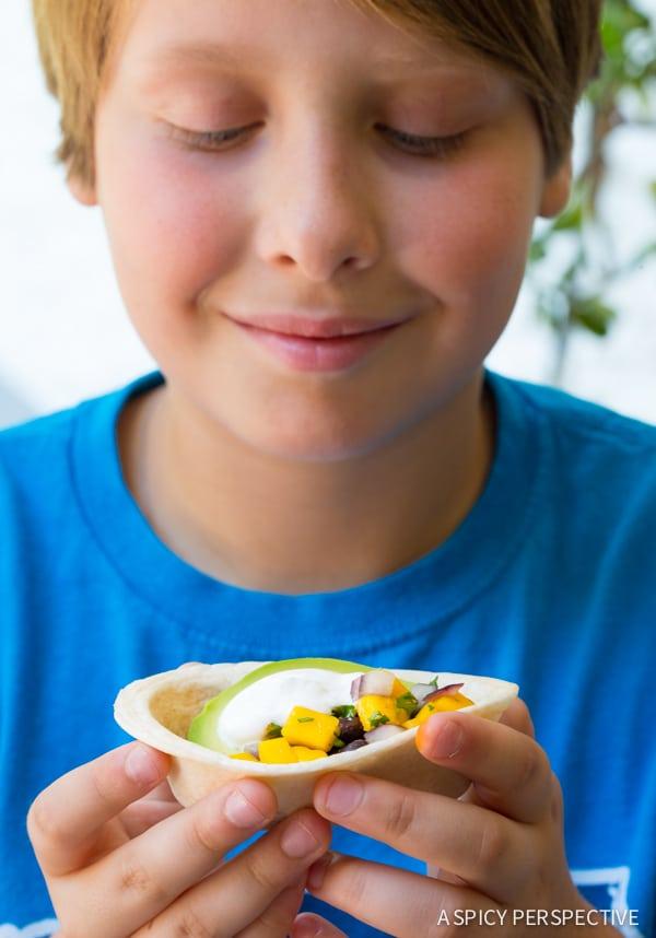 Kids love these Mini Black Bean Tacos with Mango Pico de Gallo on ASpicyPerspective.com #mexican #vegetarian