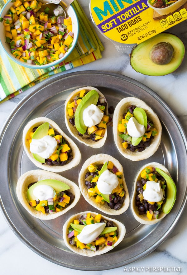 The Best Mini Black Bean Tacos with Mango Pico de Gallo on ASpicyPerspective.com #mexican #vegetarian
