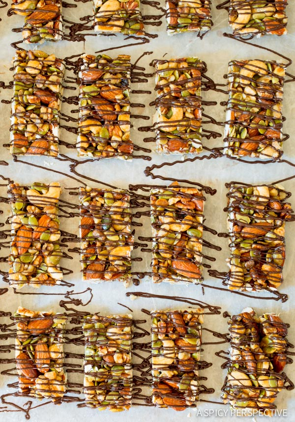 The BEST Paleo Nut Bar Recipe with Chocolate Drizzle on ASpicyPerspective.com #paleo #vegan #glutenfree