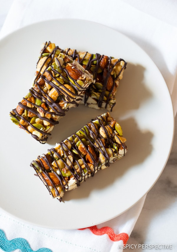 Absolutely Love These Paleo Nut Bar Recipe with Chocolate Drizzle on ASpicyPerspective.com #paleo #vegan #glutenfree