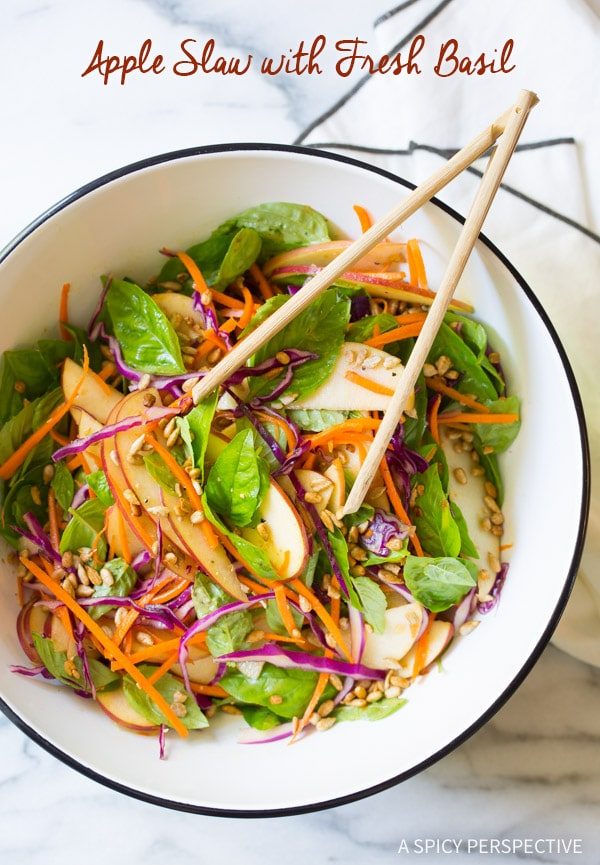6 Ingredient Easy Apple Slaw Salad with Fresh Basil Leaves and Sunflower Seeds on ASpicyPerspective.com