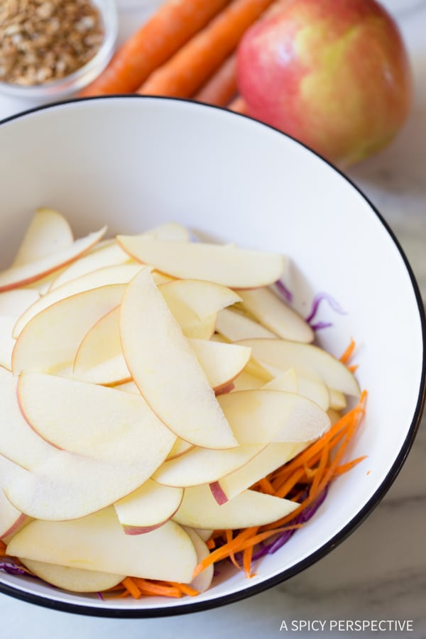 Crunchy Apple Slaw Salad with Fresh Basil Leaves and Sunflower Seeds on ASpicyPerspective.com