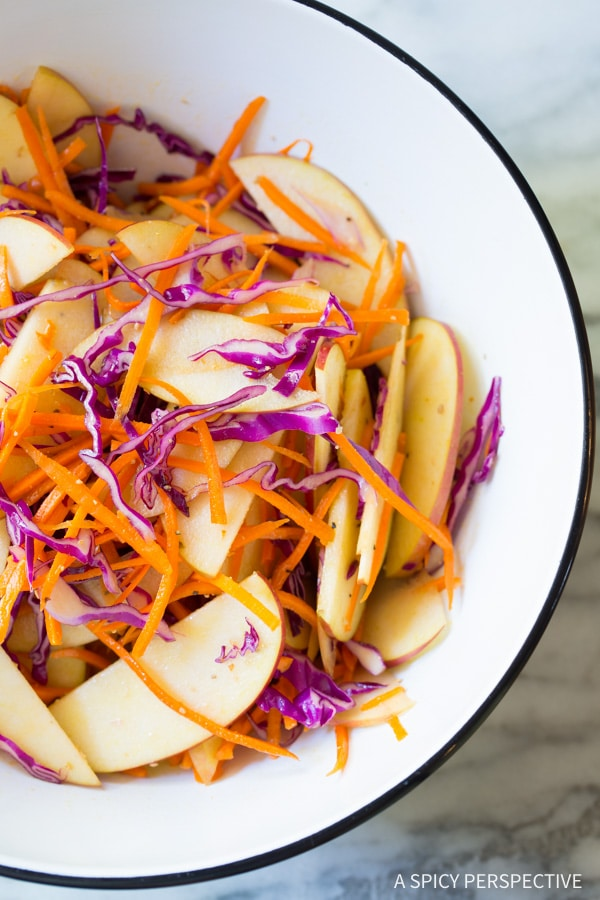 How to Make Easy Apple Slaw Salad with Fresh Basil Leaves and Sunflower Seeds on ASpicyPerspective.com