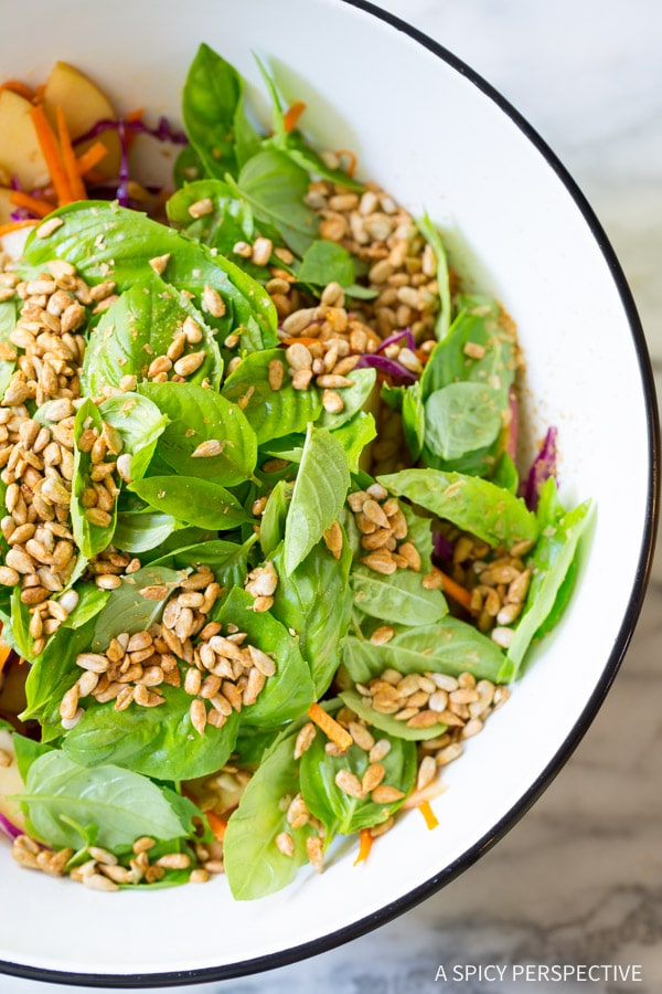 Crisp Apple Slaw Salad with Fresh Basil Leaves and Sunflower Seeds on ASpicyPerspective.com