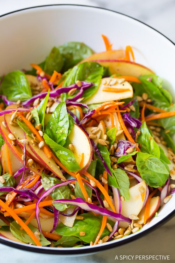 Must-Make Apple Slaw Salad with Fresh Basil Leaves and Sunflower Seeds on ASpicyPerspective.com