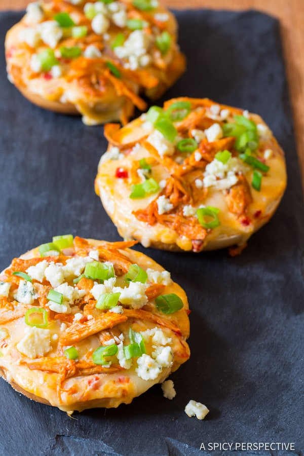 Cheesy Buffalo Chicken Pimento Cheese Pizza Bagels on ASpicyPerspective.com. 7-Ingredients, Loads of Flavor!