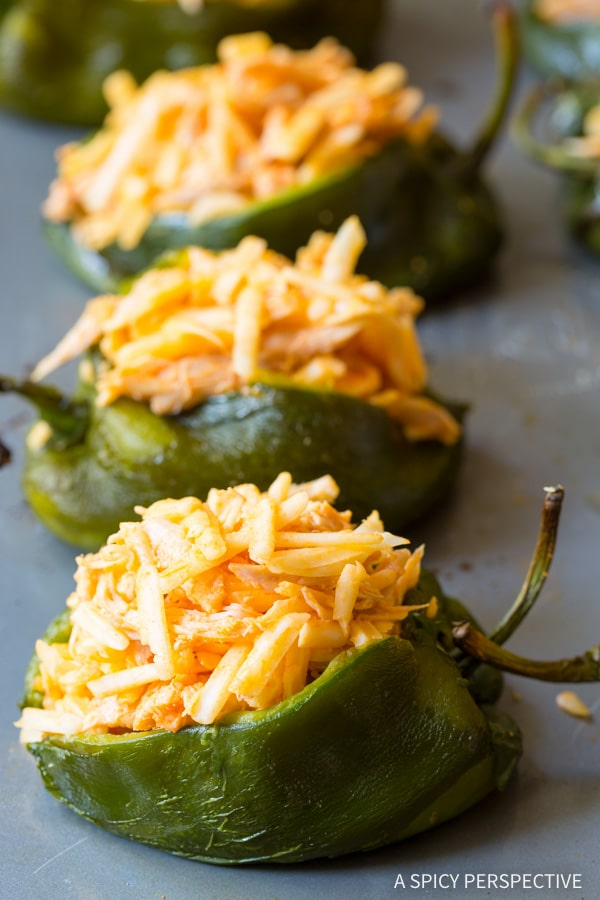 Chicken Stuffed Peppers #ASpicyPerspective #BuffaloChicken #PoblanoPeppers #StuffedPeppers #ChickenStuffedPeppers #BuffaloChickenStuffedPeppers #Dinner #MexicanFood