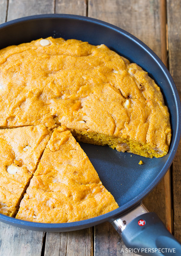 Skillet Pumpkin Blondie Recipe on ASpicyPerspective.com - Buttery and tender with a strong pumpkin spice flavor! #InLove