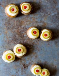 So much fun! Spooky 5-ingredient Stuffed Mushroom Eyeballs for Halloween on ASpicyPerspective.com