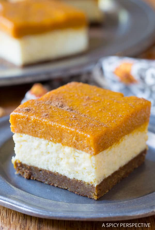 Yummazing Layered Pumpkin Cheesecake Bars on ASpicyPerspective.com