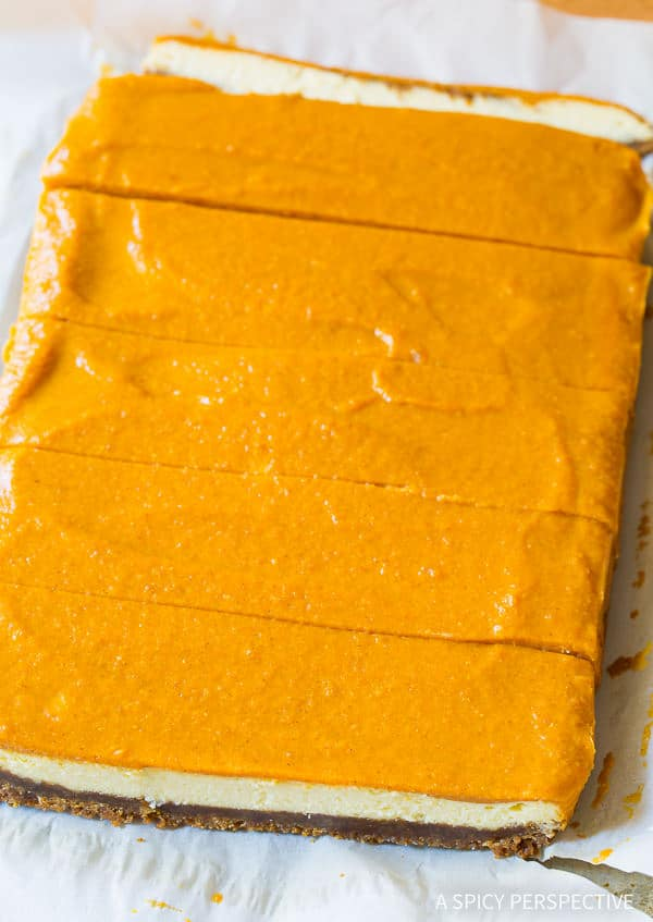 Thanksgiving Idea: Layered Pumpkin Cheesecake Bars on ASpicyPerspective.com