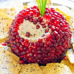 Love this 7-Ingredient Holiday Pomegranate Crusted Cheese Ball Recipe on ASpicyPerspective.com