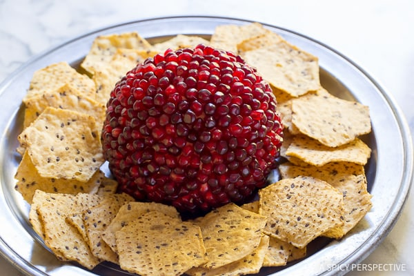 Dazzling 7-Ingredient Holiday Pomegranate Crusted Cheese Ball Recipe on ASpicyPerspective.com