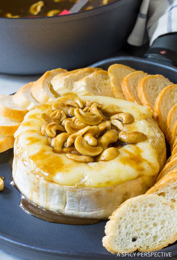Come to Mama! Baked Brie with Cashews and Bourbon Brown Sugar Glaze Recipe on ASpicyPerspective.com. #holidays #christmas