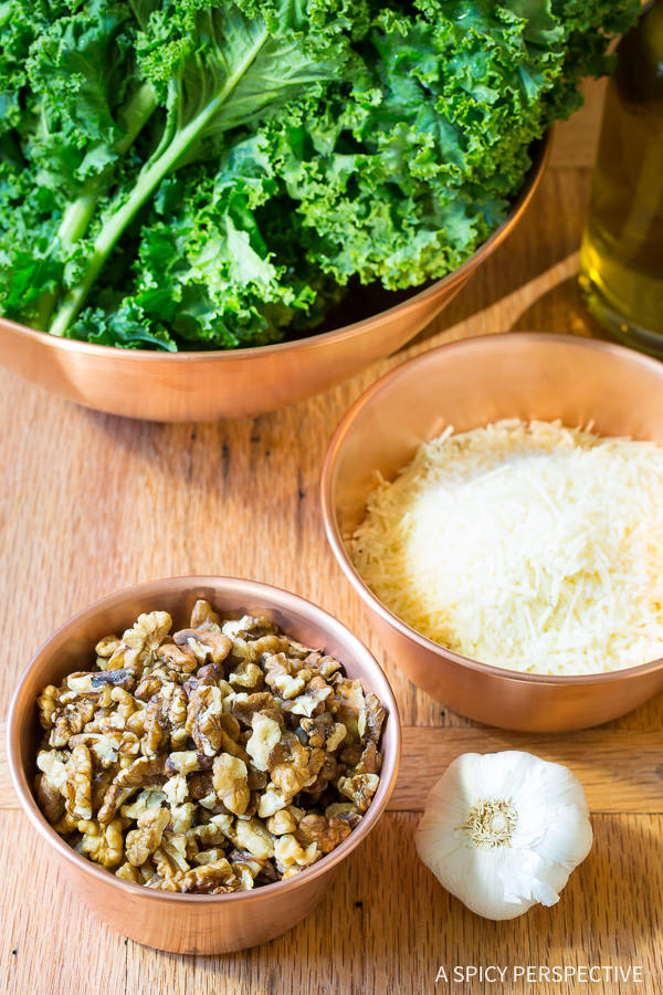 Making 5-Ingredient 5-Minute Kale Pesto Recipe on ASpicyPerspective.com #paleo #glutenfree #vegan