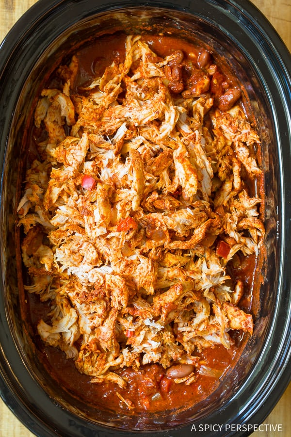 I love this Healthy Slow Cooker Roasted Red Pepper Chicken Chili Recipe (Gluten Free & Dairy Free) | ASpicyPerpective.com