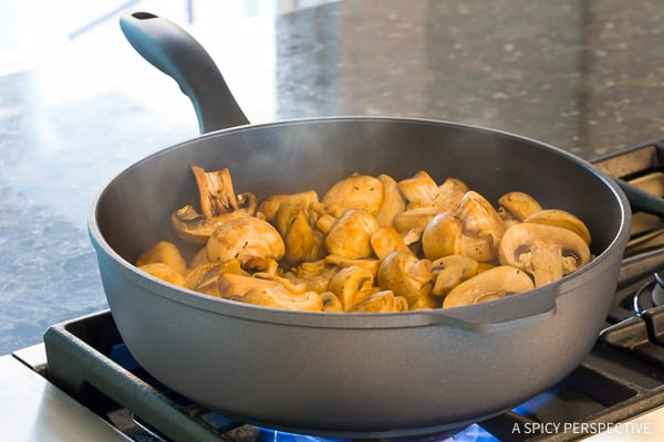 How to Make the BEST Sautéed Mushroom Recipe for topping steaks or risotto on ASpicyPerspective.com