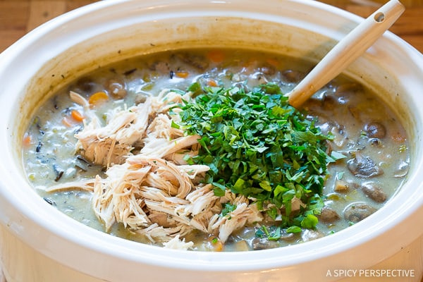 Love this Healthy Slow Cooker Chicken Wild Rice Soup (Low Fat, Gluten Free, Dairy Free) | ASpicyPerspective.com