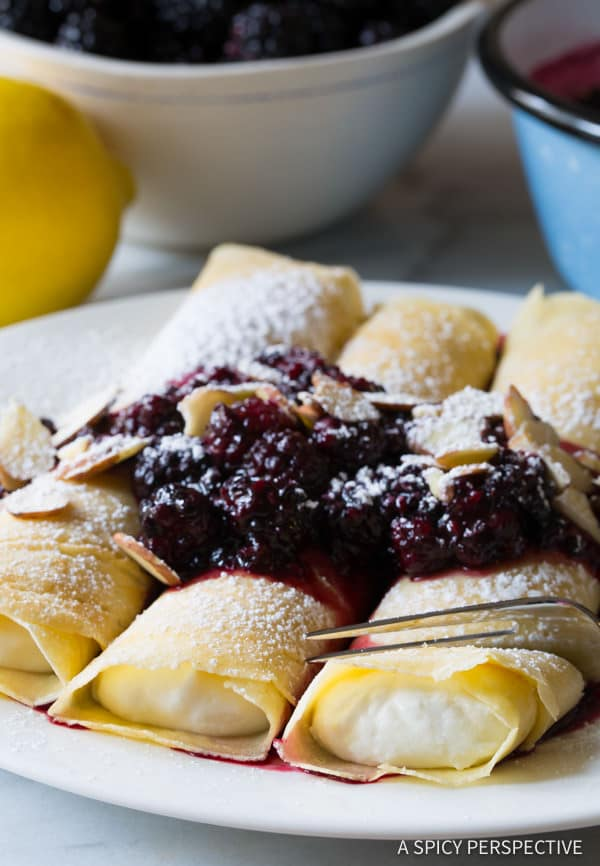 Heavenly Cream Filled Blintz Pancakes Recipe with Blackberry Sauce | ASpicyPerspective.com
