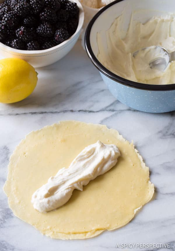 How to Make Cream Filled Blintz Pancakes Recipe with Blackberry Sauce | ASpicyPerspective.com
