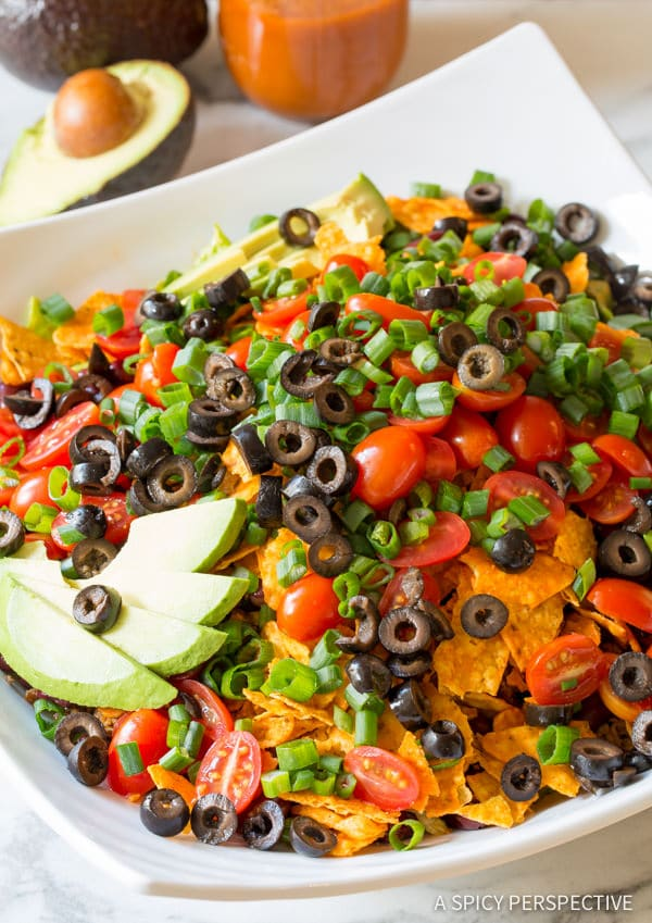 Green Onions, Olives and Avocado #ASpicyPerspective #TacoSalad #TacoSaladRecipe #DoritoTacoSalad #DoritoTacoSaladRecipe #Doritos #TacoSaladDressing #HowtoMakeTacoSalad #TacoSaladIngredients #Salad