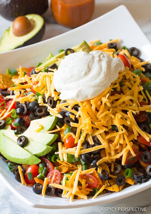 Cheese and Sour Cream Toppings #ASpicyPerspective #TacoSalad #TacoSaladRecipe #DoritoTacoSalad #DoritoTacoSaladRecipe #Doritos #TacoSaladDressing #HowtoMakeTacoSalad #TacoSaladIngredients #Salad