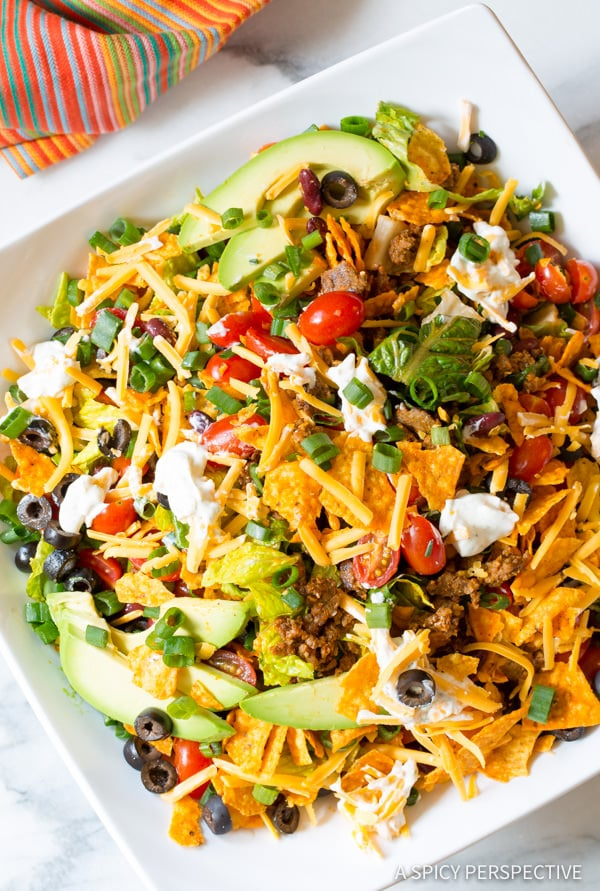 Taco Salad Recipe #ASpicyPerspective #TacoSalad #TacoSaladRecipe #DoritoTacoSalad #DoritoTacoSaladRecipe #Doritos #TacoSaladDressing #HowtoMakeTacoSalad #TacoSaladIngredients #Salad