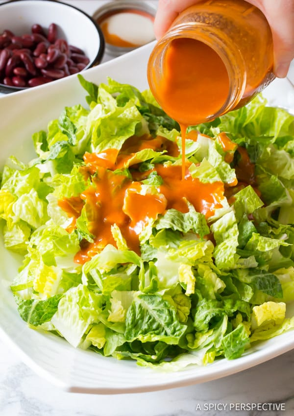 Catalina Dressing Over Romaine Lettuce #ASpicyPerspective #TacoSalad #TacoSaladRecipe #DoritoTacoSalad #DoritoTacoSaladRecipe #Doritos #TacoSaladDressing #HowtoMakeTacoSalad #TacoSaladIngredients #Salad