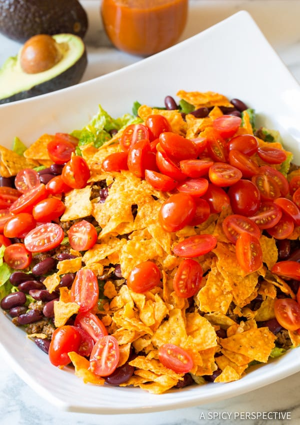 Adding Grape Tomatoes and Crushed Doritos #ASpicyPerspective #TacoSalad #TacoSaladRecipe #DoritoTacoSalad #DoritoTacoSaladRecipe #Doritos #TacoSaladDressing #HowtoMakeTacoSalad #TacoSaladIngredients #Salad