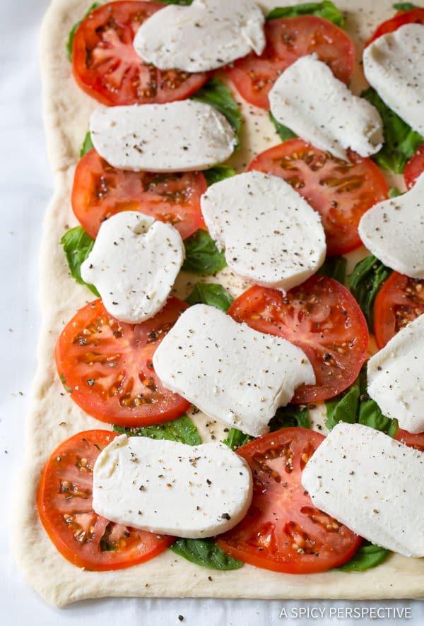 Easy to Make Caprese Flatbread Recipe with Cheese Stuffed Crust! | ASpicyPerspective.com
