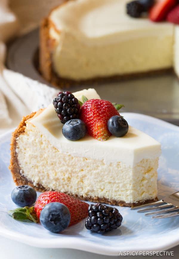 Limoncello Cheesecake with Biscoff Crust #ASpicyPerspective #Cheesecake #HomemadeCheesecake #Limoncello #LimoncelloCake #LimoncelloCheesecake #Biscoff #BiscoffCookie #CookieCrust #Dessert
