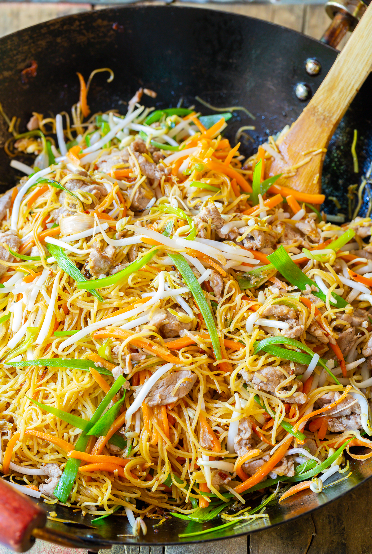 Cantonese Pan Fried Noodles (Pork Lo Mein) - Our pan fried noodles AKA pork lo mein recipe is savory, slightly spicy, and packed with flavor. Made with fresh veggies and stir fried pork, it's a light and healthy dish that's easy to make in only 30 minutes! #cantonesenoodles #panfriednoodles #lomein #porklomein #aspicyperspective