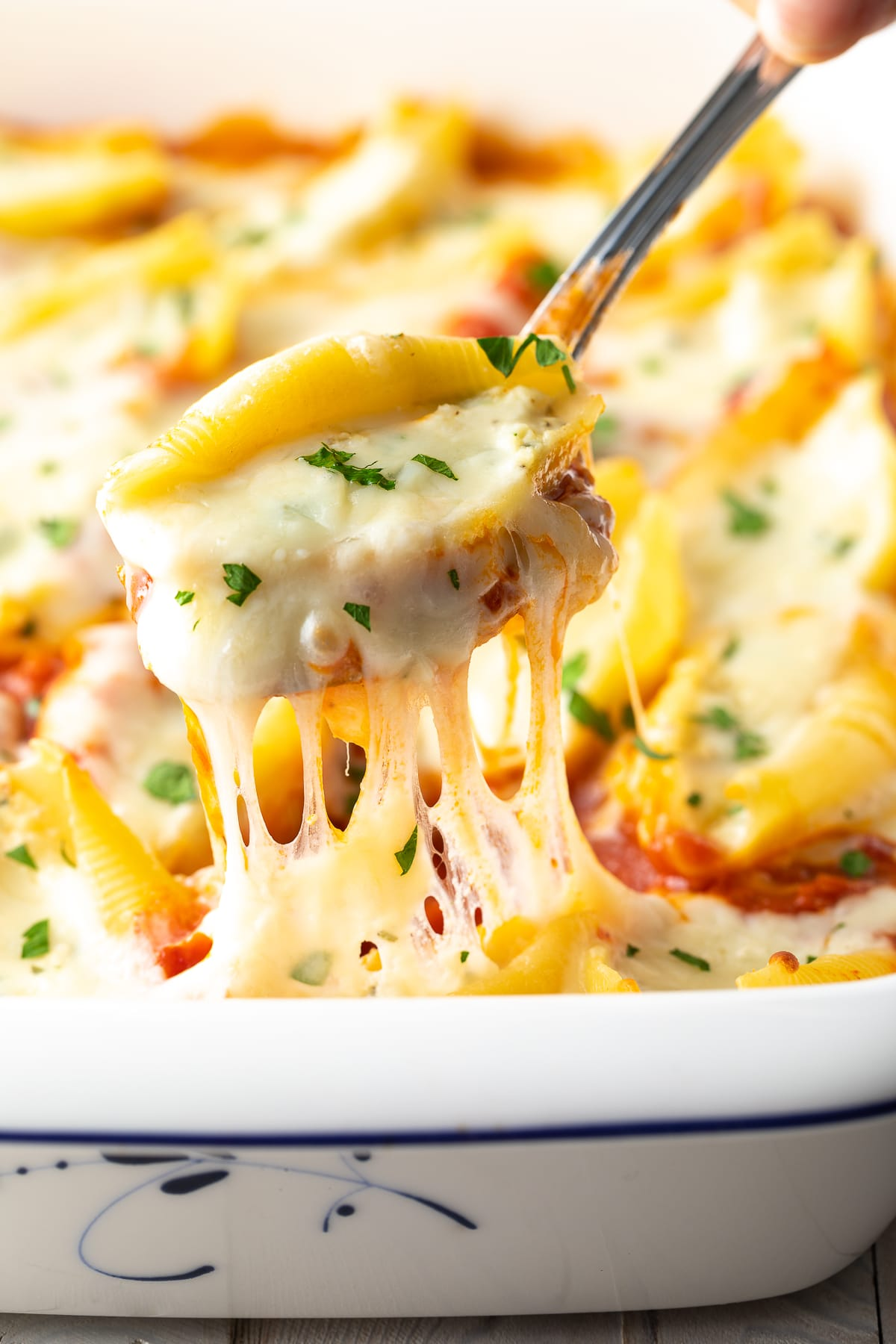 Best Classic Ricotta Stuffed Shells Recipe #ASpicyPerspective #stuffed #shells #ricotta #holiday #italian #comfortfood #pasta #baked #slowcooker #crockpot