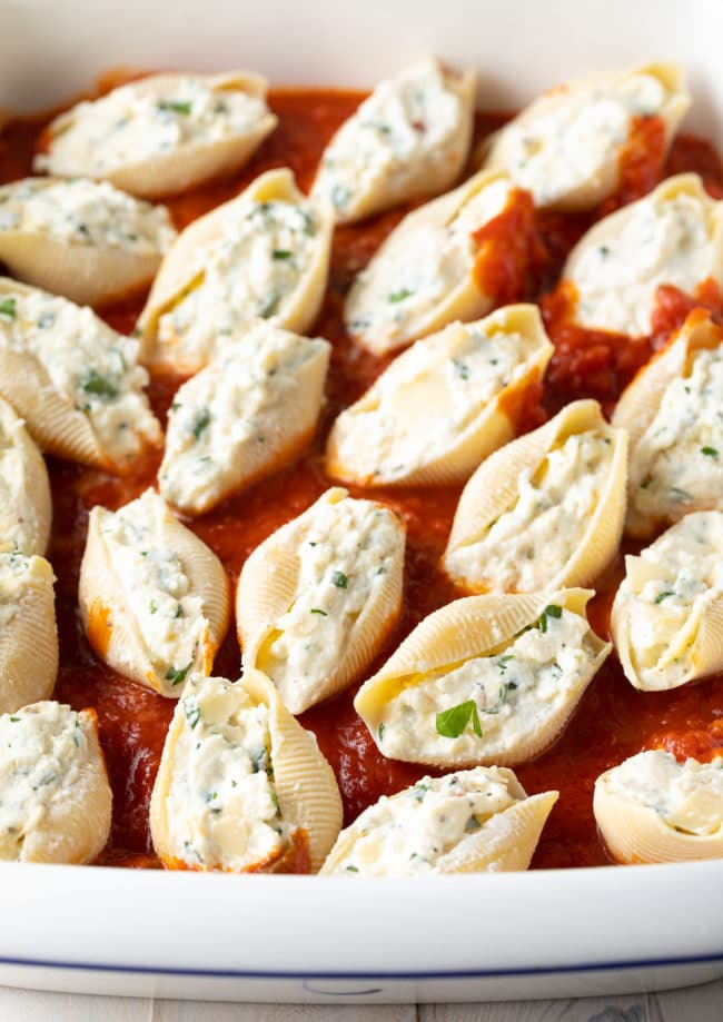 Stuffed Shells in Sauce #ASpicyPerspective #stuffed #shells #ricotta #holiday #italian #comfortfood #pasta #baked #slowcooker #crockpot