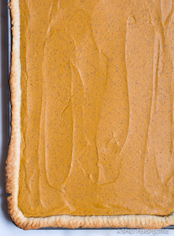 Simple Secret Ingredient Perfect Pumpkin Slab Pie Recipe | ASpicyPerspective.com #halloween #thanksgiving