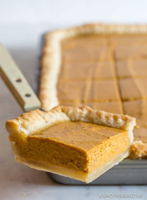 Amazing Secret Ingredient Perfect Pumpkin Slab Pie Recipe | ASpicyPerspective.com #halloween #thanksgiving