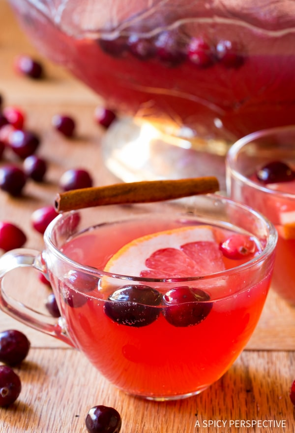 Perfect Holiday Champagne Punch Recipe on ASpicyPerspective.com #newyearseve #christmas