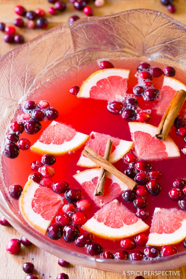 5-Ingredient Holiday Champagne Punch Recipe on ASpicyPerspective.com #newyearseve #christmas