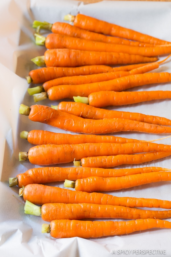 Making 5-Ingredient Honey Butter Roasted Carrots | ASpicyPerspective.com #holiday #recipe