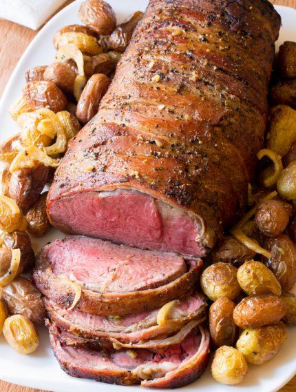 Slow Cooker Honey Garlic Beef Tenderloin Recipe   ASpicyPerspective.com #holiday #christmas #crockpot