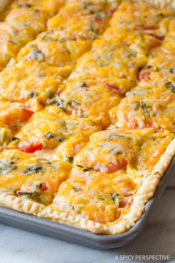 Baked Southern Tomato Pie #ASpicyPerspective #Pie #SlabPie #TomatoPie #TomatoPieRecipe #SouthernTomatoPie #Tomatoes #Summer #Dinner