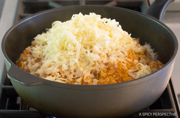 Making Cheesy Enchilada Rice Recipe