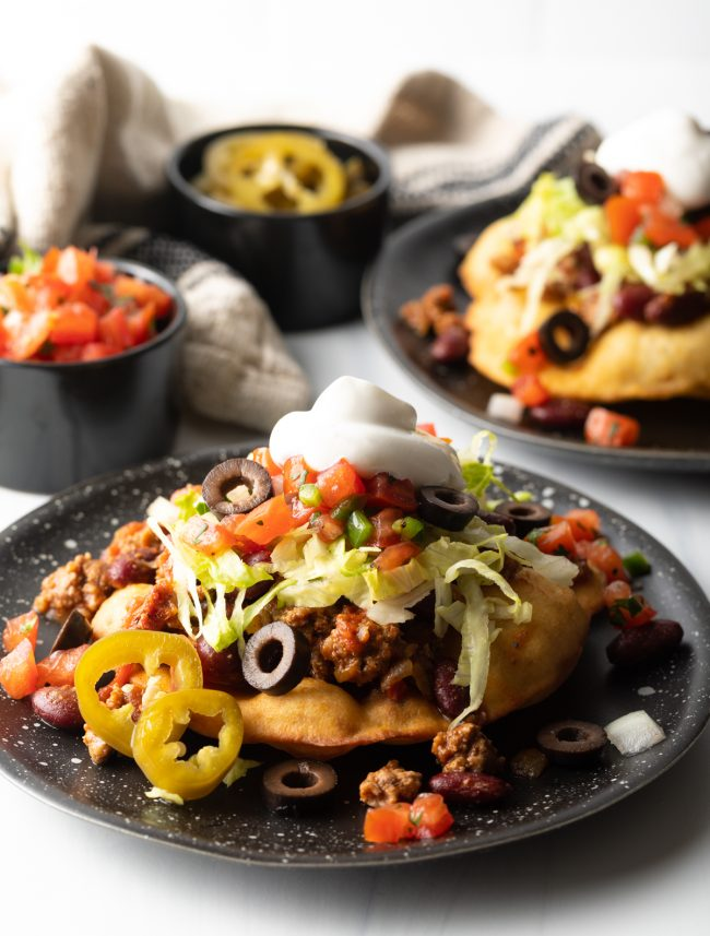 Indian tacos served on a black dish