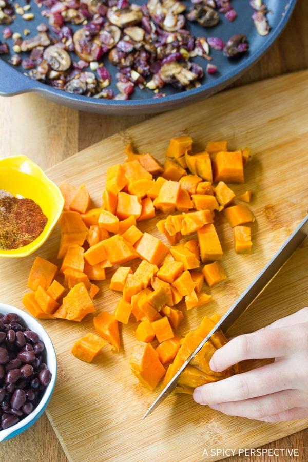 Making Vegetarian Black Bean Sweet Potato Skillet Enchiladas Recipe