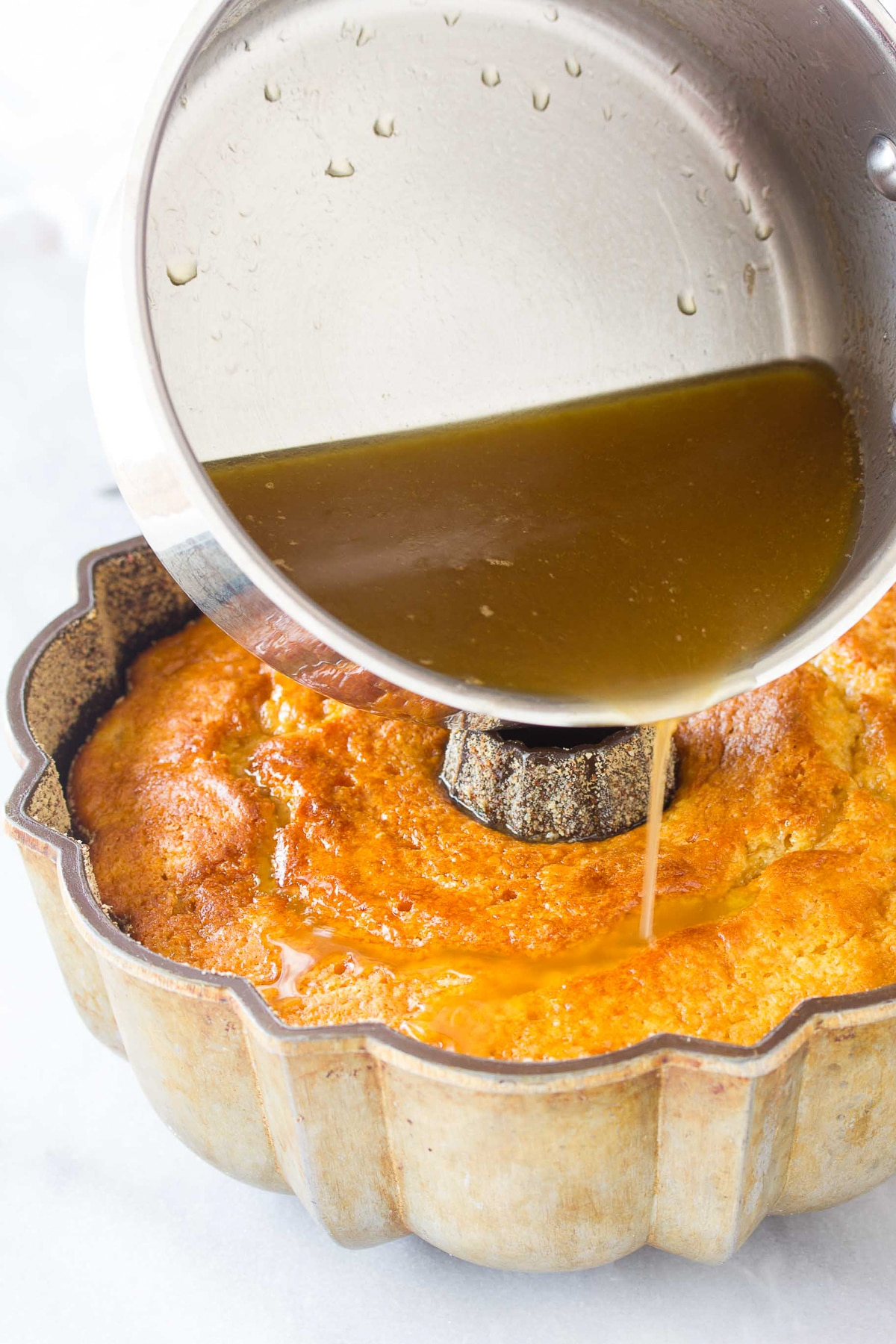 Easy Rum Cake #ASpicyPerspective #bundtcake #spicecake #rum #rumcake #caribbean #holiday #coconut #pineapple