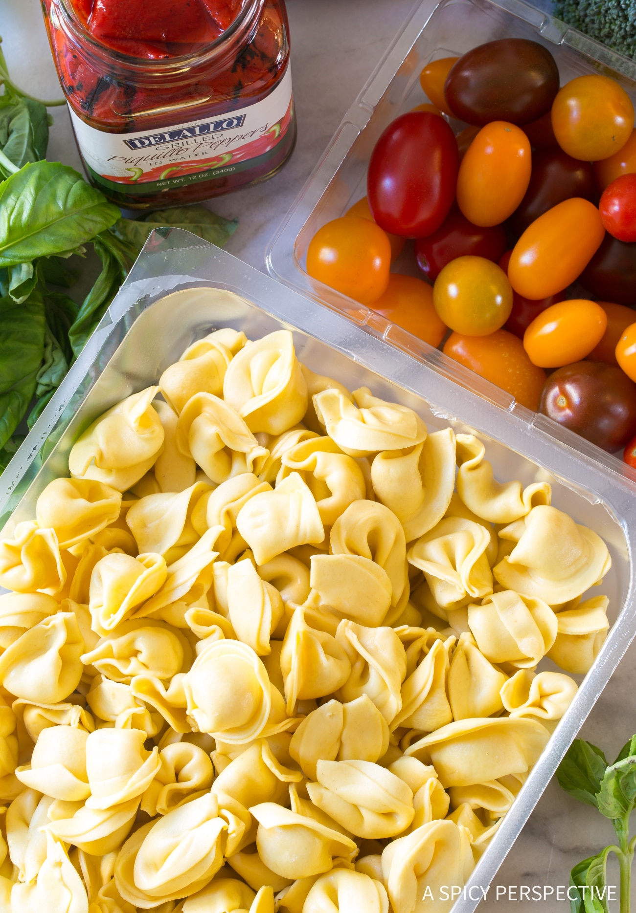 Making Tortellini Salad with Basil Vinaigrette Recipe