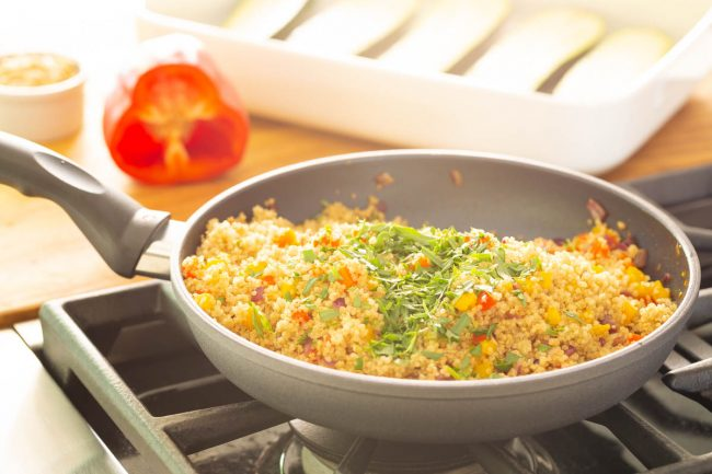 quinoa and pine nut mixture cooking on the stove