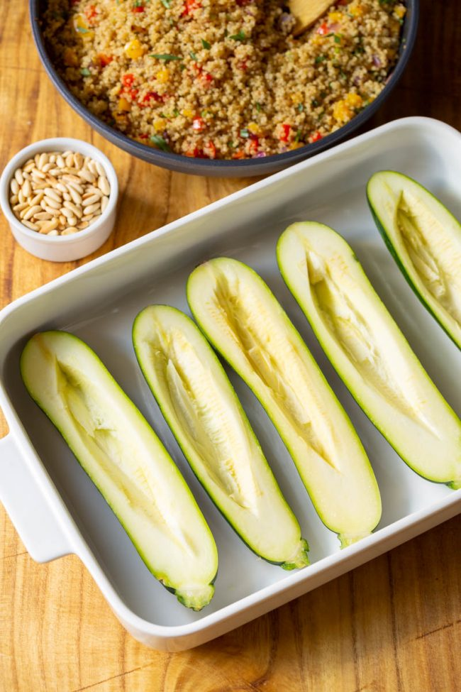 halved zucchini ready to be stuffed